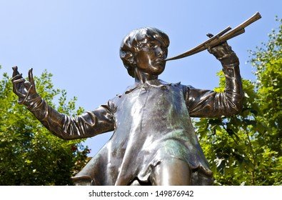 LONDON, UK - JULY 13, 2013: Peter Pan statue in Kensington Gardens, London.