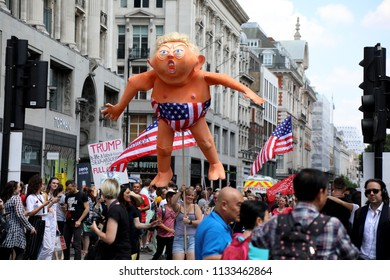 London, UK – July 13, 2018: An effigy of US president Donald Trump is help up by protesters involved in an anti-Trump march in central London, during his visit to the UK.