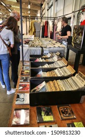 LONDON, UK - JULY 13, 2019: People shop for collectible CDs and vinyl records at Backyard Market in Spitalfields district of London. Brick Lane area is known for its multiple market places.