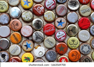 LONDON, UK - JULY 13, 2019: Mixed beer and non alcoholic beverages metal bottle caps in London UK.