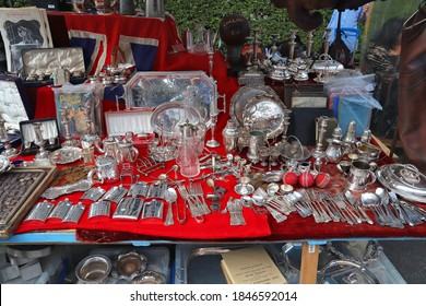 LONDON, UK - JULY 13, 2019: Antique silverware stall at Portobello Road Market in Notting Hill district of London. Portobello Road Market is famous for antiques and collectibles.