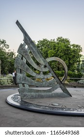 LONDON, UK - JULY 14, 2018: View of Sundial on Tower Hill. Sundial on Tower Hill was unveiled in 1992. Around actual sundial are reliefs which commemorate important events from history of London.