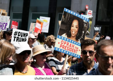 LONDON, UK - July 14th 2018: A group of people holding placards for potential Oprah Winfrey 2020 presidential election candidacy