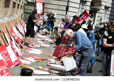 LONDON, UK - July 14th 2018: Protestors make personalised placards at an anti Trump protest in central London