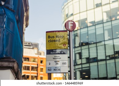 London, UK - July 15, 2019: Closed bus stop in the City of Westminster due to the maintenance works. A bus stop is a designated place where buses stop for passengers to board or alight from a bus