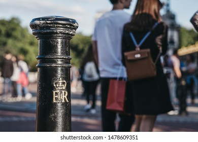 London, UK - July 15, 2019: Royal cypher of HM the Queen Elizabeth II (EIIR) on a post outside Buckingham Palace, London. Queen Elizabeth II is the longest-lived and longest-reigning British monarch.