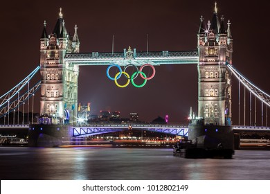 London, UK - JULY 15: Tower Bridge at night with Olympic Symbol during London 2012 Olympic Games in London on JULY 15, 2012.