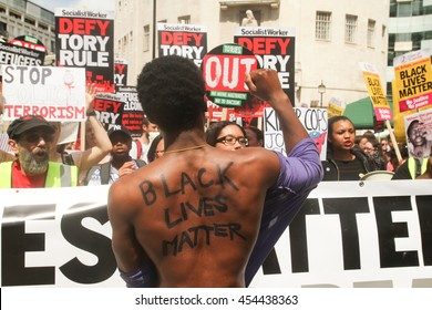 LONDON, UK - JULY 16 2016: A man with the words 'Black Lives Matter' written on his back seen at the front line ahed of the People's Assembly march.