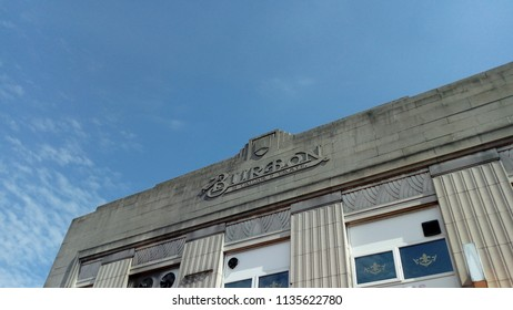LONDON/ UK - JULY 16 2018: The historic store front, and stone carved emblem of Burtons the tailers, is famous in every town and city in the UK. The store was founded 115 years ago in 1903