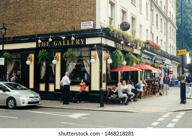 London, UK / July 16 2019: people seating at the tables outside the Gallery Pub on the Lupus Street in Pimlico, London, UK. Pubs are the big part of British culture
