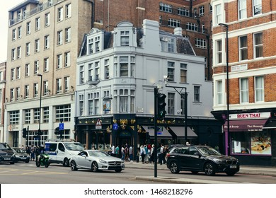 London, UK / July 16 2019: people walking past the White Swan Pub on Vauxhall Bridge Road in London, UK. Pubs are the big part of British culture