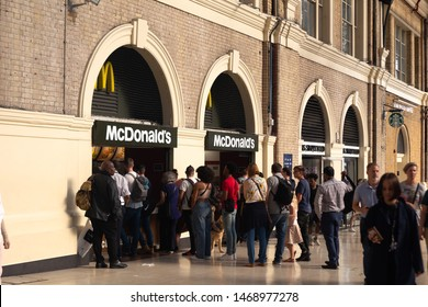 London, UK / July 16 2019: que to Macdonalds on the Victoria Railroad Station in London, UK. McDonald's is the world's largest restaurant chain by revenue