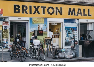 London, UK - July 16, 2019: Young men on bikes relaxing outside Brixton Mall. Brixton, South London, is a multiethnic community, with a large percentage of its population of Afro-Caribbean descent