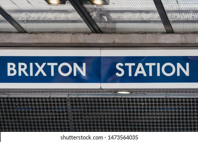 London, UK - July 16, 2019: Name sign at the entrance of a Brixton London Underground station in Brixton, Borough of Lambeth, South London.