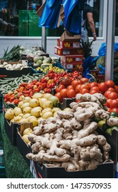 London, UK - July 16, 2019: Fresh vegetables on sale in Brixton Market, a community market run by local traders in the centre of Brixton, South London. Selective focus.