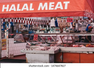 London, UK - July 16, 2019: Exterior of Halal Meat Store at Brixton Market, a community market run by local traders in the centre of Brixton, south London.