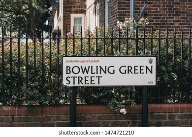 London, UK - July 16, 2019: Street name sign on a fence in Bowling Green Street in Lambeth, a borough in South London, England, which forms part of Inner London.