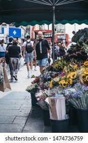 London, UK - July 16, 2019: Flower stall on a street in Brixton, South London, selective focus. Brixton is a multicultural area, with a large percentage of its population of Afro-Caribbean descend.