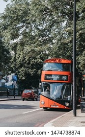 London, UK - July 16, 2019: Bus 159 towards Streatham Station on a street in Brixton, South London. Brixton is a multicultural area, with a large percentage of its population of Afro-Caribbean descend