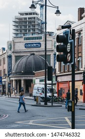 London, UK - July 16, 2019: People walking on a street in London in front of Brixton O2 Academy, one of Londons leading music venues, nightclubs and theatres.