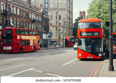 London / UK - July 16, 2019: Passengers getting on a red doubledecker bus towards Streatham Station on the Brixton Road in Lambeth