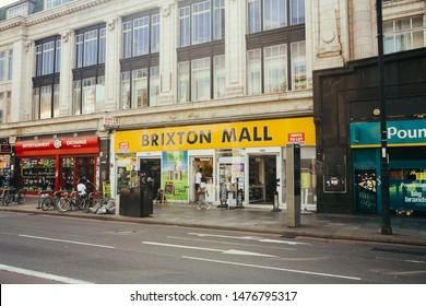 London / UK - July 16, 2019: people walking past the Brixton Mall entrance  on the Brixton Road in Lambeth