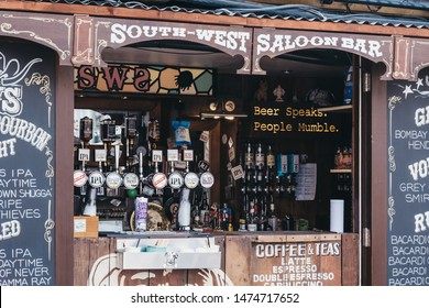London, UK- July 16, 2019:Facade of South West Saloon Bar inside Pop Brixton, event venue and the home of a community of independent retailers, restaurants, street food startups and social enterprises