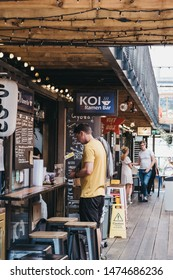 London, UK - July 16, 2019:Man ordering food from KOI Ramen in Pop Brixton, event venue and the home of a community of independent retailers, restaurants, street food startups and social enterprises