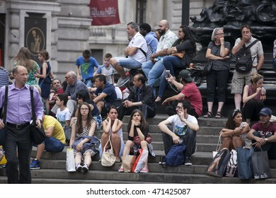 London, UK - July 17, 2016. LONDON - MAY 23: Piccadilly Circus with unidentified people  in London. Its status as major traffic junction  made Piccadilly Circus busy meeting place, tourist attraction