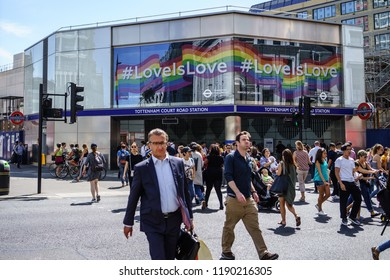London, UK - July 17, 2017: People are crossing the street of one of busy place in London, Tottenham Court Road