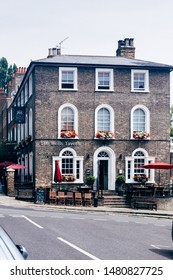 London, UK - July 17, 2019: The Wells Tavern is a Grade II listed public house at 30 Well Walk, Hampstead, London. It was built in about 1849