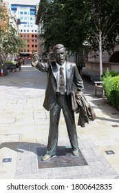 London / UK - July 17 2020: Sculpture of a City Worker Hailing a Cab / Taxi! on John Carpenter Street, London