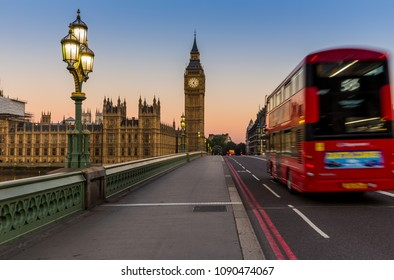 London, UK - July 17,2016 - Big Ben and red bus in London at sunrise