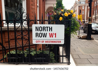 London / UK - July 18, 2019: North Row Street name sign in City of Westminster which occupies much of the central area of Greater London