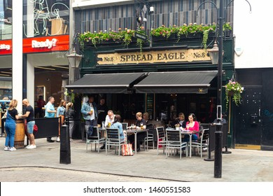 London, UK / July 18 2019: people having lunch at Spread Eagle pub on Woodstock Street in London