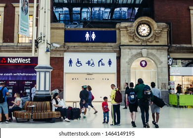 London / UK - July 18, 2019: public toilet on the Victoria station, one of the busiest stations in London; selective focus, motion blur