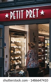 London, UK - July 18, 2019: Woman in Petit Pret A Manger shop in Marylebone, London, a popular international sandwich shop chain that is based in UK and has approximately 500 shops in nine countries.