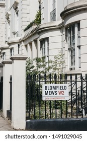 London, UK - July 18, 2019: Street name sign on a fence in Blomfield Mews, City of Westminster, a borough that occupies much of the central area of London including most of the West End.