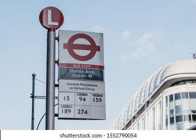 London, UK - July 18, 2019: Close up of a bus stop sign next to Marble Arch Station, London, an Underground Station named after 9th-century white marble-faced triumphal arch in Central London.