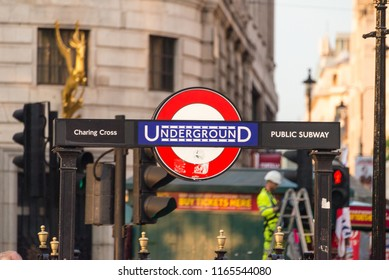London, UK  - July 19 2018:  Charring cross London underground sign and a busy background in London, UK. Transportation concept.