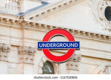 London, UK  - July 19 2018: Isolated London underground sign and church in the background in London, UK. Transportation concept.