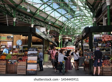 London, UK: July 1st 2019 - Borough Market in the London Bridge area is one of London's oldest markets and has become a trendy foodie destination