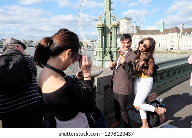London, UK - July 2, 2017: Happy tourist taking photo with Mr. Bean lookalike, a British celebrity comedian at Westminster Bridge, London.