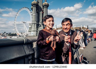 London, UK - July 2, 2017: Happy young boy posing with Mr. Bean lookalike at Westminster Bridge in London, UK.