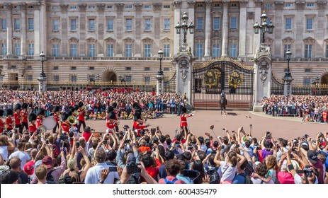 LONDON, UK - JULY 20, 2015: Royal Guards during traditional Changing of the Guards ceremony near Buckingham Palace. This ceremony is one of the most popular tourist attractions in London.