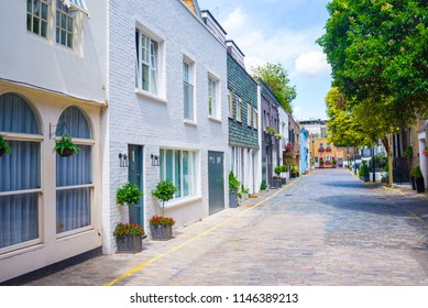 London, UK - July 2018: Exclusive mews with colored luxury residential houses in Marylebone, a weatlhy borough of central London