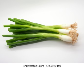 London, UK - July 2019 – Bunch Of Spring Onions On A White Background