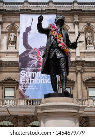 London UK, July 2019. Royal Academy of Arts Building (Burlington House), photographed during the annual Summer Exhibition. The statue is of Sir Joshua Reynolds, one time head of the Royal Academy.
