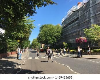 London UK - July 2019 tourists recreating abbey road zebra crossing scene to be like the Beatles Abbey Road Album