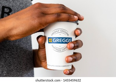 London, UK, July 2019, Woman is holding a Gregg's Greggs Coffee Take Away Cup.